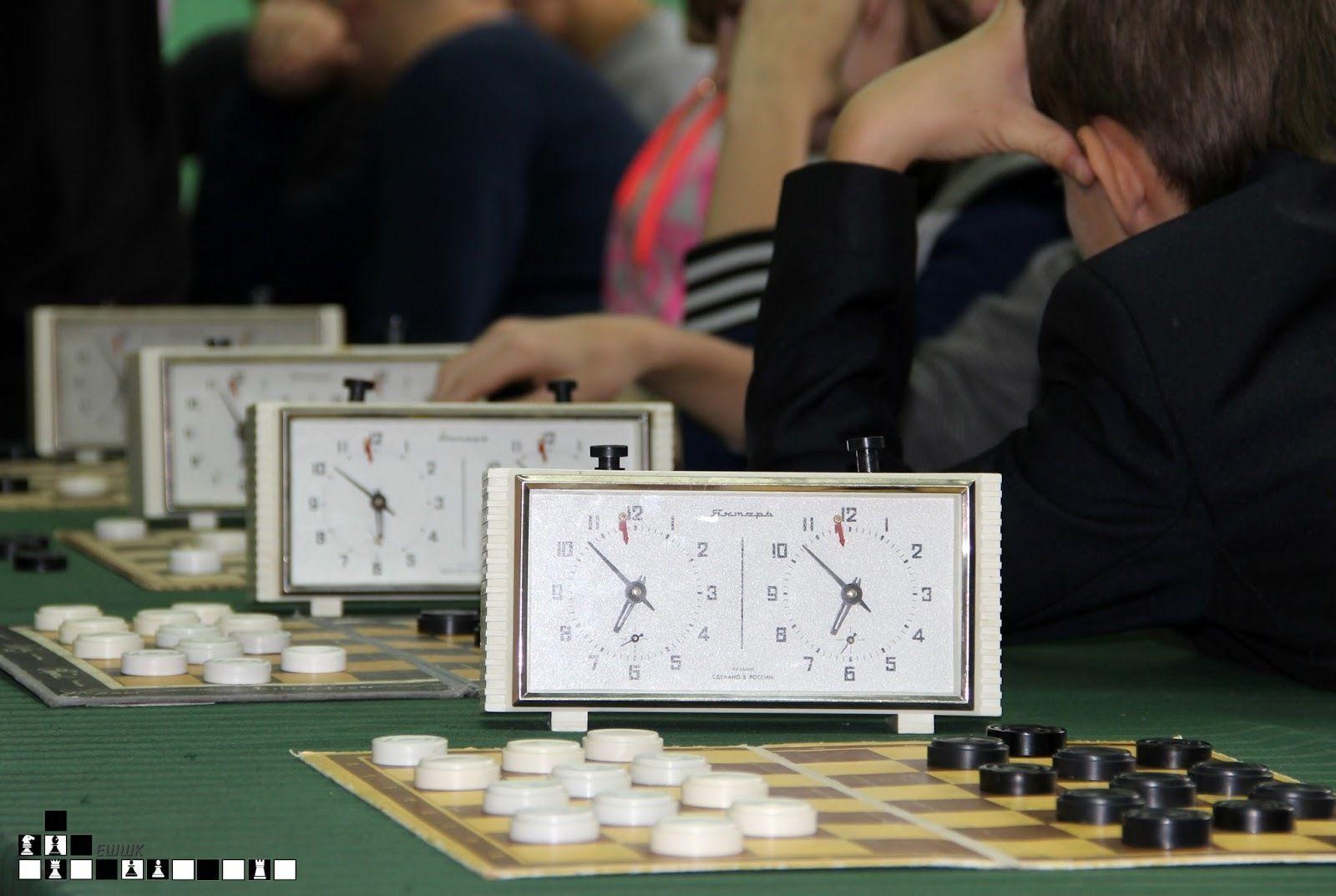 Первенство по шашкам и шахматам